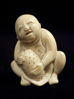 Boy with fruit netsuke