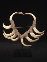 Oceanic Art - Boar's tusk mouth ornament, Papua New Guinea